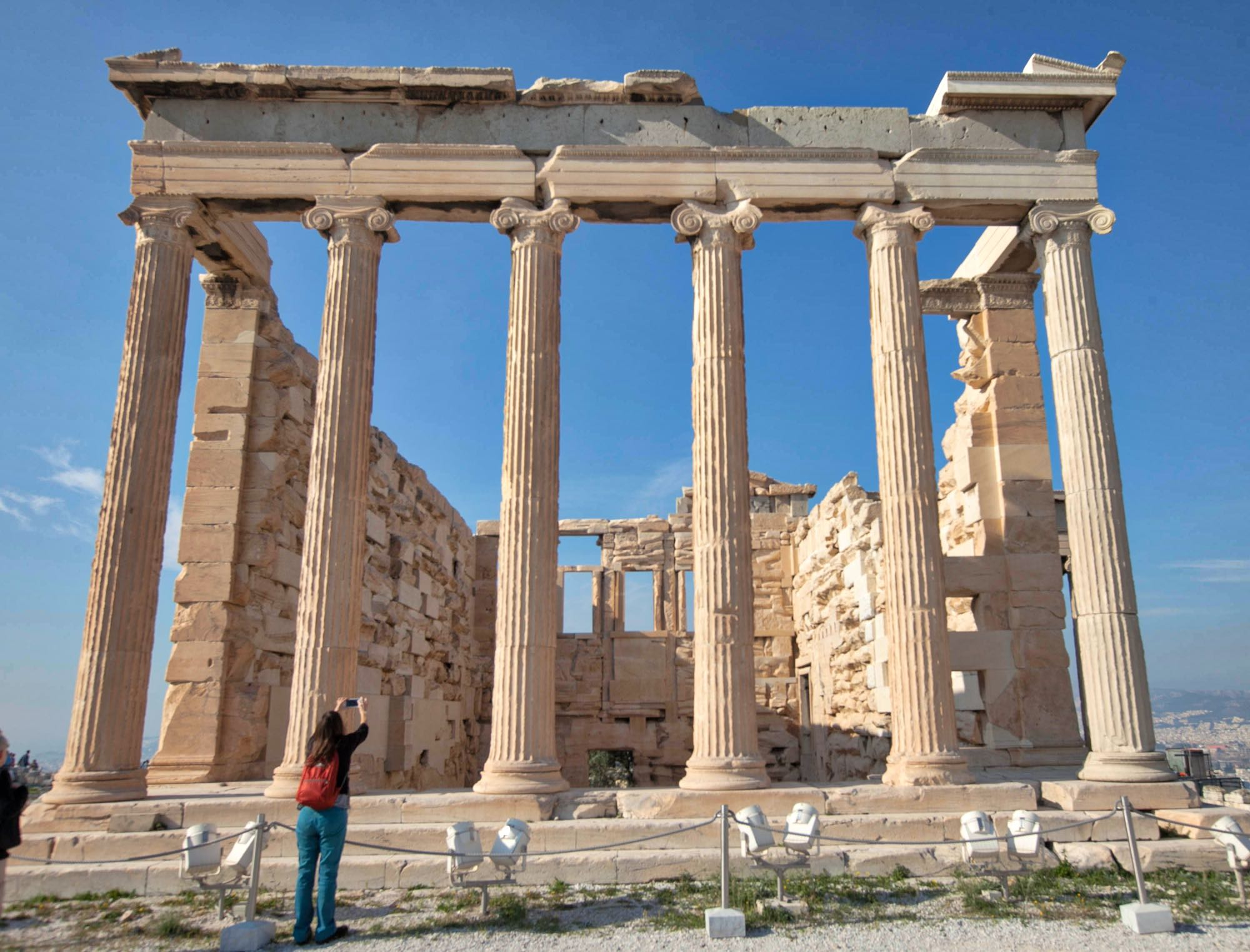 The Erechtheion or Erechtheum. an ancient Greek temple on the north side of the Acropolis of Athens dedicated to Athena and Poseidon