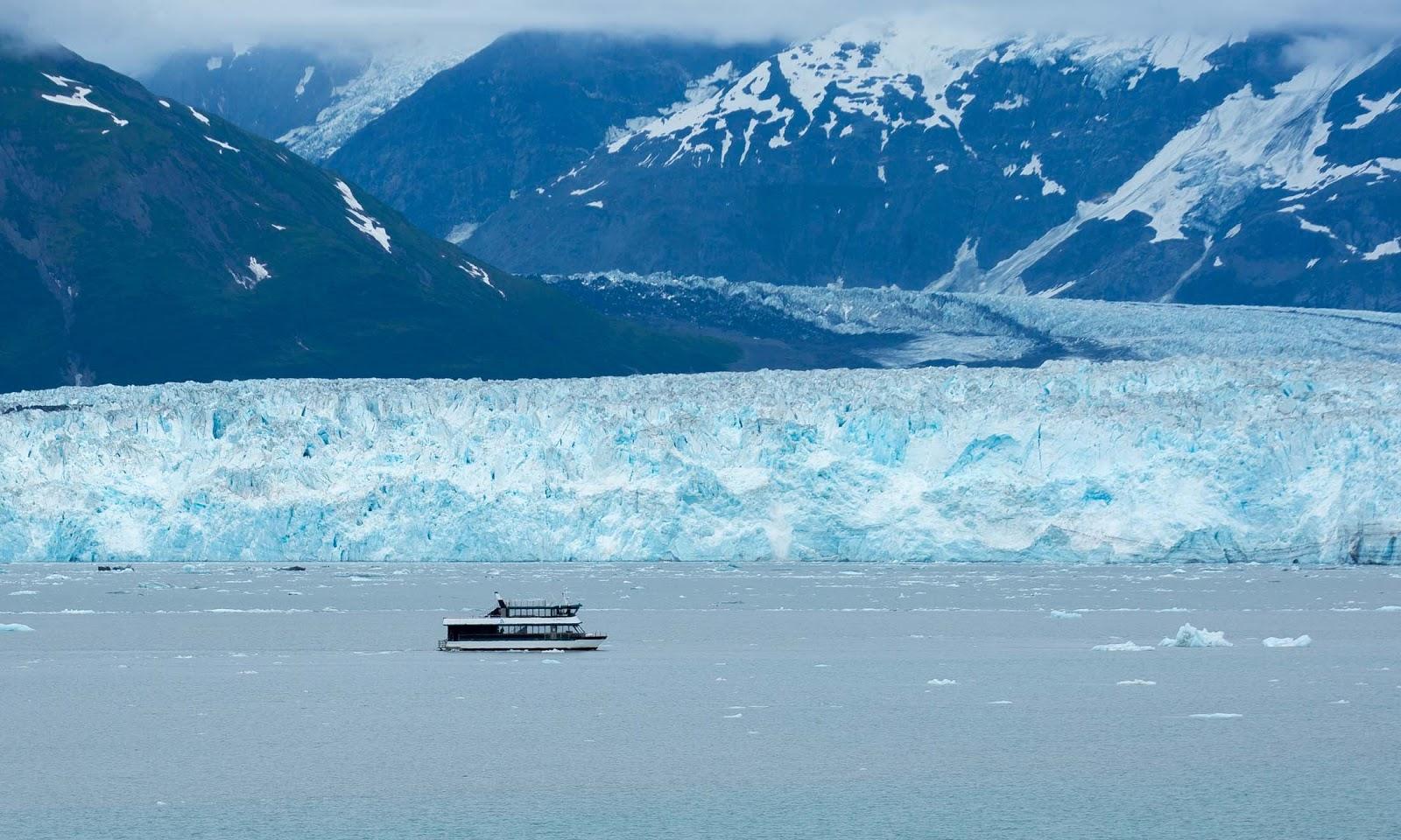 Tour boat passes along Hubbard Glacier
