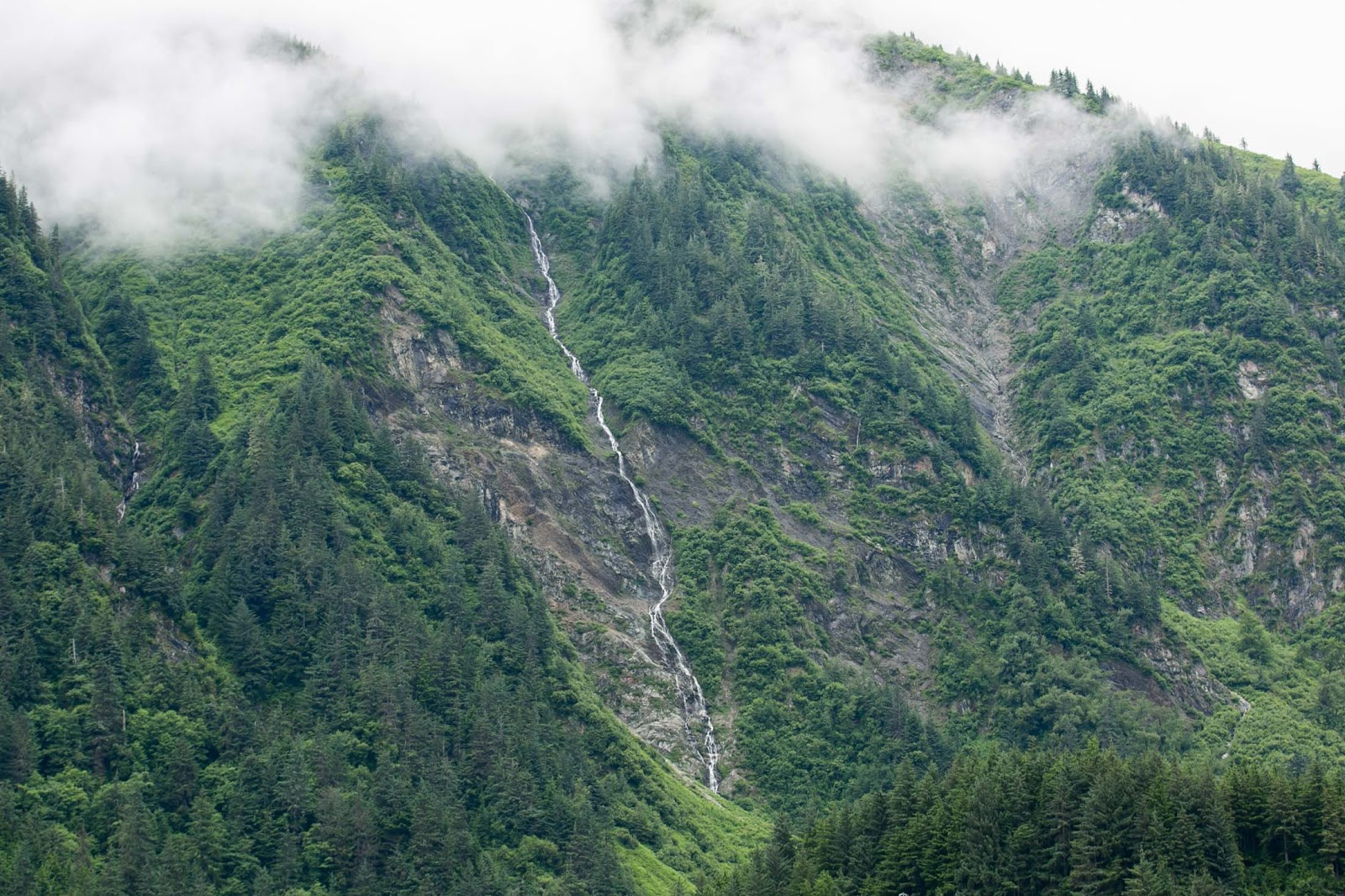 Waterfall snakes down mountain in Juneau