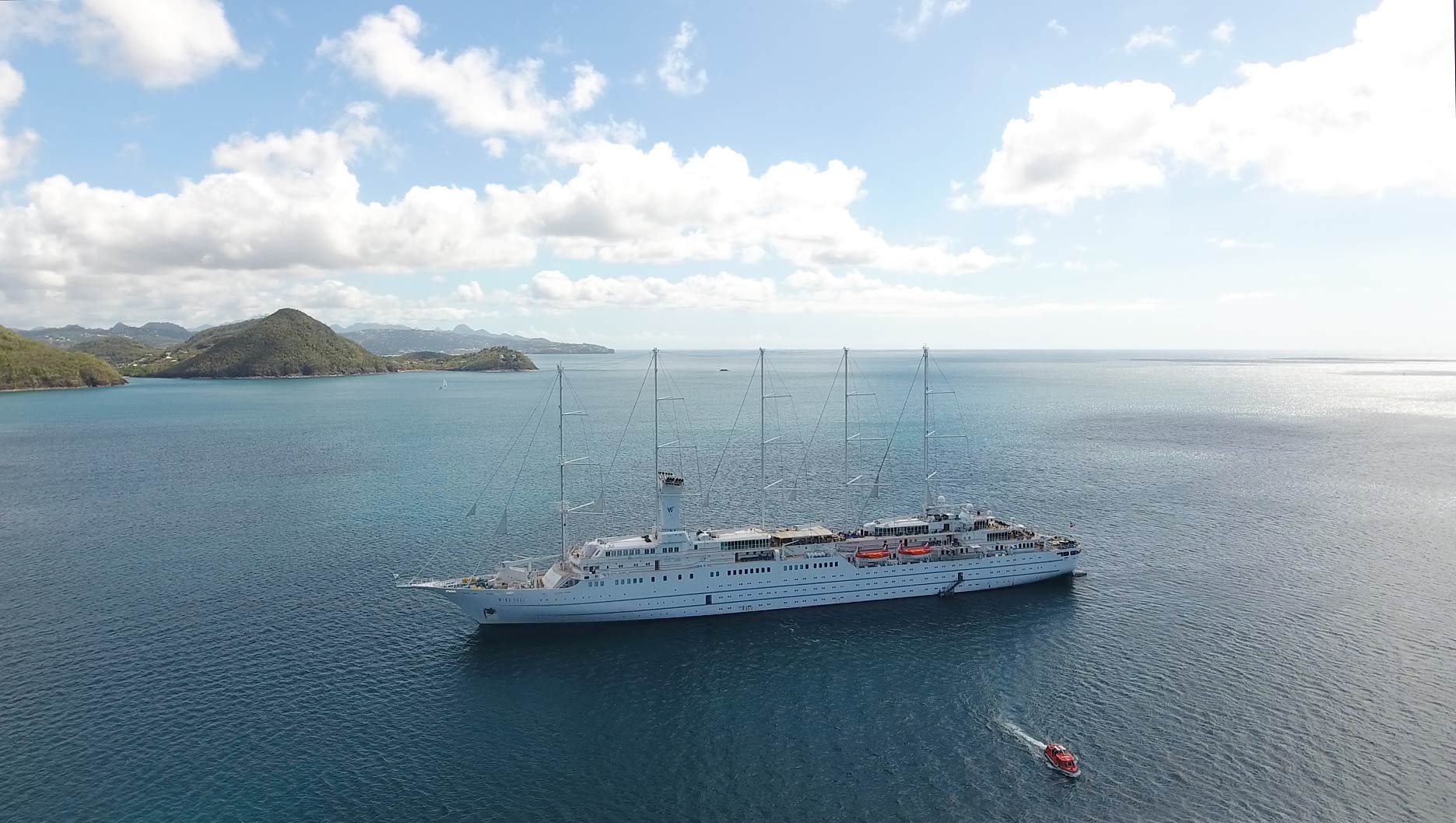 Drone approaches Wind Surf in bay in St. Lucia