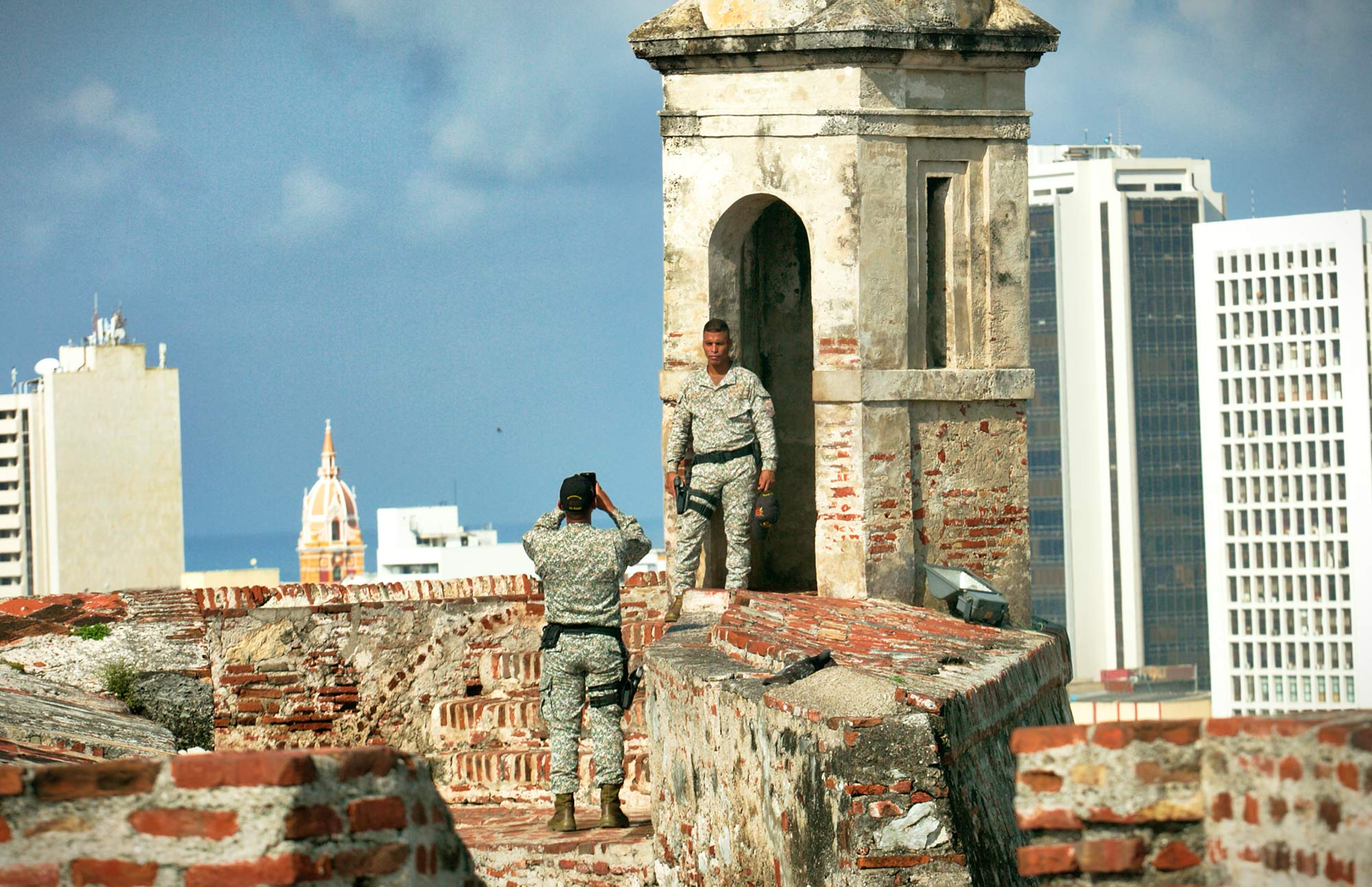 Soldier poses at Castillo San Felipe de Barajas