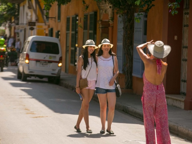 Visitors pose in Old Cartagena