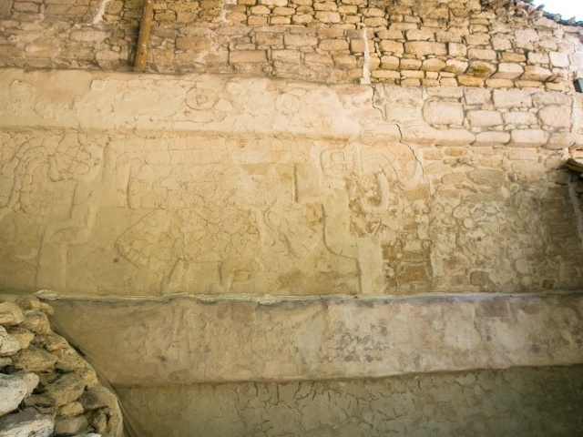 Carvings on a stepped pyramid at the Mayan ruins of Dzibanche in Mexico