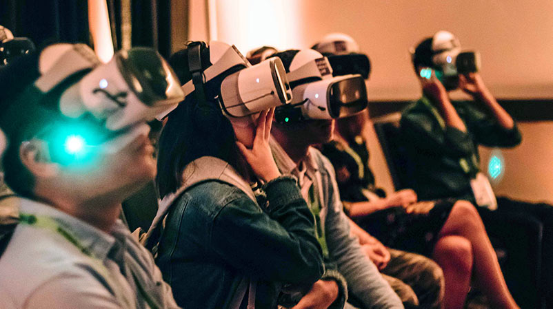 Participants don virtual reality headsets at an event put on by NYU's Future Reality Lab.
