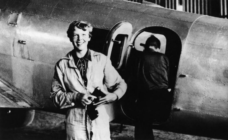 Amelia Earhart standing by her Lockheed Electra in Natal, Brazil, in June 1937. Her plane vanished over the Pacific less than a month later.